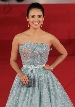 A Swarovski bracelet and clutch, worn by actress Zhang Ziyi